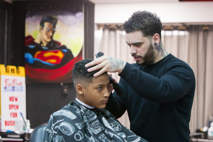 Artist Eddie Rivera, of Meriden, cuts Devontay Jordan's hair Monday at Feel Fresh Hair Studio in Meriden.