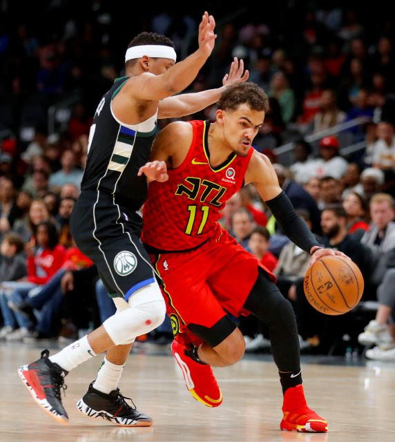 FILE - In this March 31, 2019, file photo, Atlanta Hawks guard Trae Young (11) drives to the basket as Milwaukee Bucks guard Tim Frazier (12) defends in overtime of an NBA basketball game, in Atlanta. With a pair of picks in the top 10 — or perhaps a single selection that
