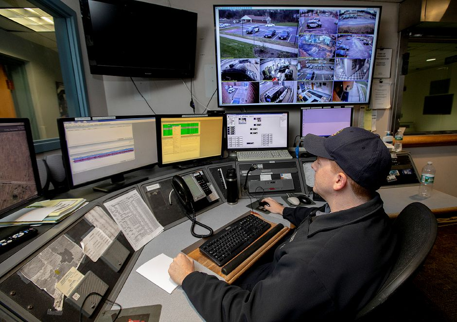 Dispatcher Ron Henri works at his post at the Cheshire Police Dept., Fri., Dec. 14, 2018. Five officers and two dispatchers including Henri were recognized for their actions during an officer-involved shooting earlier this year. Dave Zajac, Record-Journal