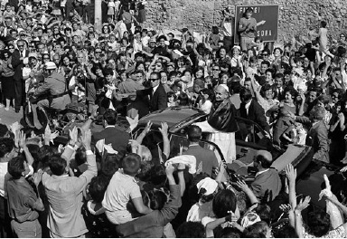 Pope Paul VI, standing in open car, salutes cheering crowds as he passes through Madonna delle Nevi village near Frosinone, Italy, Sept. 1, 1966. The pontiff was on a tour of several medieval towns near Rome. (AP Photo/Mario Torrisi)