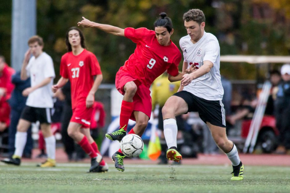 Denys Fuentes scored the game-winning goal as time expired in Cheshire's 2-1 soccer victory Tuesday at Amity. | Justin Weekes / Special to the Record-Journal
