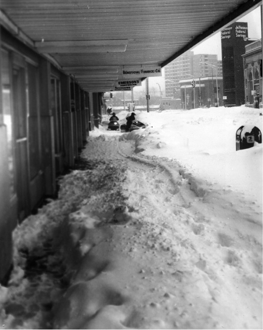 Snowmobilers head down the sidewalks along Colony Street in Meriden during the Blizzard of 1978. | File photo / Record-Journal
