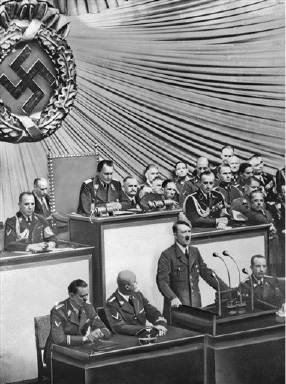 The Nazi invasion of  Poland and the start of World War II were just a few hours old when Fuehrer Adolf Hitler went before the Reichstag in Berlin on Sept. 1, 1939, to deliver a war tirade without a formal declaration of war.  From left are:  Julius Schaub, SS leader and Hitler