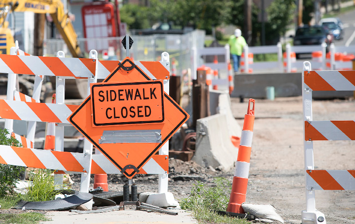 FILE PHOTO -- The west side walkway remains closed as work continues on the East Center Street bridge, Monday, July 31, 2017.   | Dave Zajac, Record-Journal