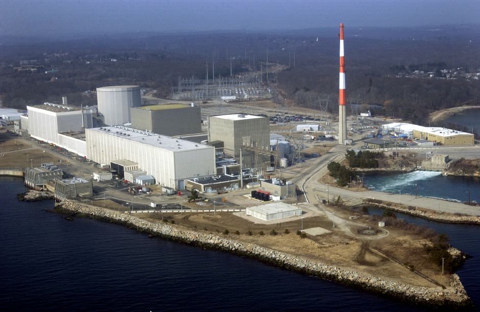 HOLD FOR STORY MOVING AUG 6 BY SUSAN HAIGH --- FILE - This March 18, 2003 aerial file photo shows the Millstone Nuclear Power Station in Waterford, Conn. Owners of the facility said they still want more than a study of the facility's future economic viability to ensure the plant remains open and continues providing more than half of Connecticut's electricity. They contend state lawmakers, who have been meeting behind closed doors during the summer of 2017 to hammer out a budget deal, must take prompt action. (AP Photo/Steve Miller, File)
