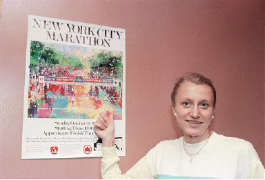 Grete Waitz, marathon runner from Norway, points to a poster promoting the New York City Marathon during a press conference in New York, Oct. 22, 1984. (AP Photo/Marty Lederhandler)