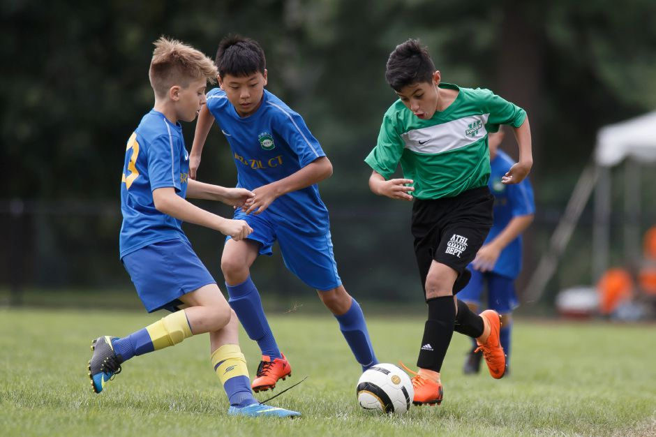 FILE – Wallingford Warriors Jayden Quintero pushes up the sideline Sunday during the annual TWIST soccer tournament at Choate Rosemary Hall in Wallingford August 19, 2018 | Justin Weekes / Special to the Record-Journal