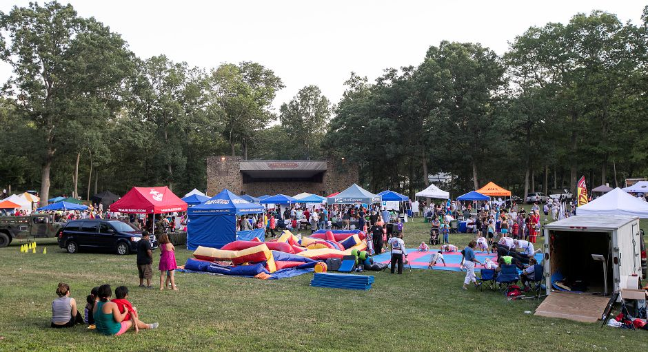 Crowds gather near the band shell during the 13th Annual National Night Out hosted by the Meriden Police Department at Hubbard Park in Meriden, Tuesday, August 1, 2017. | Dave Zajac, Record-Journal