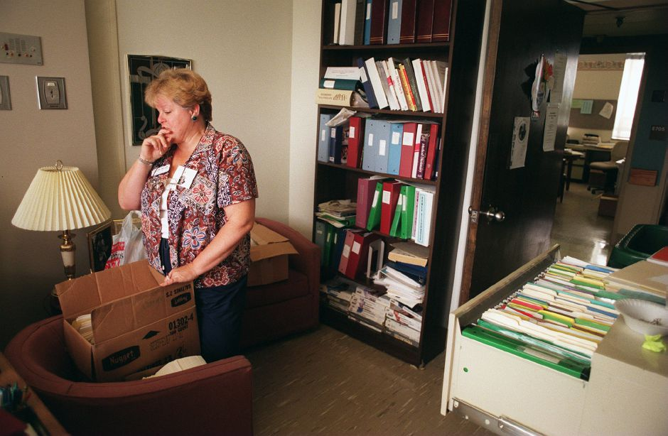 RJ file photo - Jo Ann Nelson sifts through old paperwork in the cancer care center of VMMC in preparation for the move to the new Midstate Medical Center, Aug. 1998.