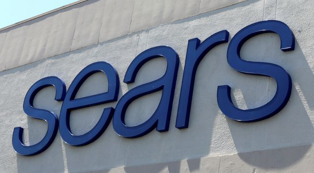 FILE - This May 11, 2017 file photo shows a Sears store in Hialeah, Fla.  Sears is closing another 72 stores after reporting a first-quarter losses and plunging sales. The struggling retailer said Thursday, May 31, 2018 that it has identified about 100 stores that are no longer turning profits, and 72 of those locations will be shuttered soon.  (AP Photo/Alan Diaz, File)