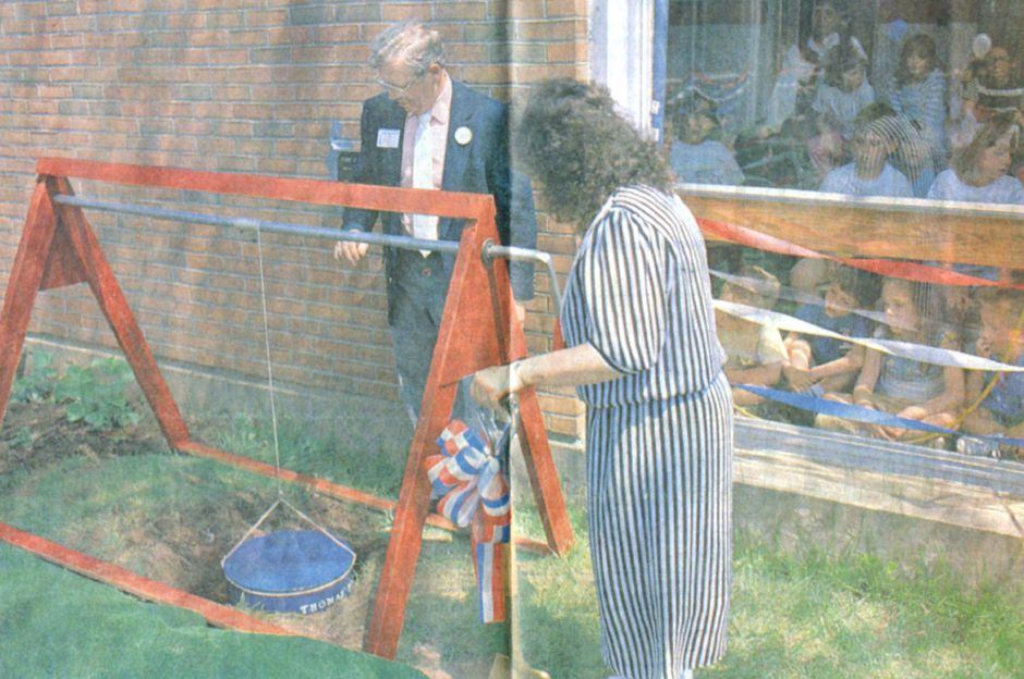 Thomas Hooker school principal Thomas Hall (L.) helps bury a time capsule at the school in 1989. | Record-Journal archives
