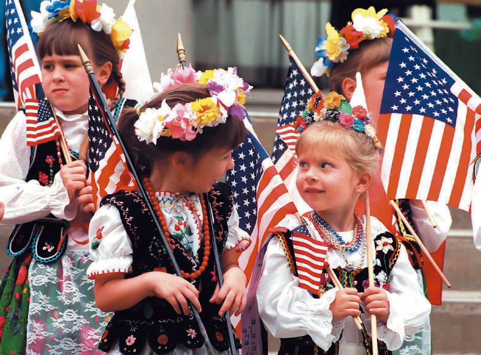 From left, Brandi Walker and her friend Elizabeth Zielinski from the Nazowsze Polish Dance Group in Wallingford wait for the Flag Day parade to begin June 12, 1999.
