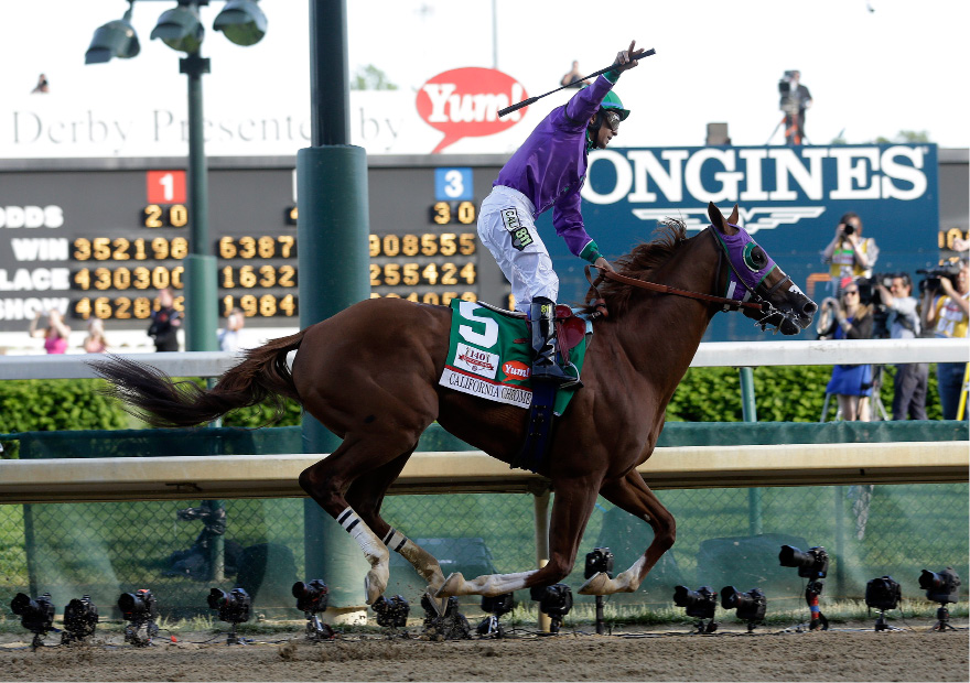 Victor Espinoza rides California Chrome to victory during the 140th running of the Kentucky Derby horse race at Churchill Downs Saturday, May 3, 2014, in Louisville, Ky. (AP Photo/Morry Gash)