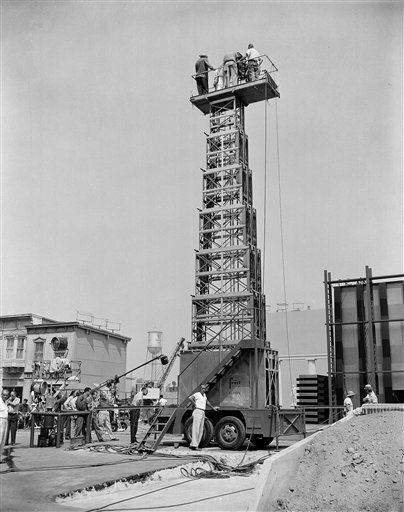 "This new camera tower makes its debut in Hollywood with the filming of ""The Silver Chalice"" in which it is used to follow the action on down shots for the some of the scenes in the picture, shown Oct. 25, 1954. Though it weighs six tons, the tower is very mobile and can be pulled behind a truck to various locations. (AP Photo)"