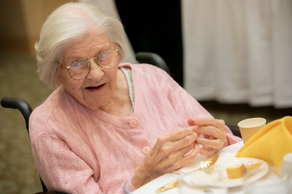 "Clara Bighinati, 104, says to dance and ""take one day at a time"" during a ""Centenarian Celebration"" at Masonicare in Wallingford, Wed., Oct. 16, 2019. The Masonicare Health Center honored 19 centenarian residents, people who have lived for at least a century, in a celebration with friends and family. Dave Zajac, Record-Journal"