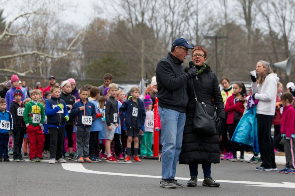 Robin and Jack Sellati sing God Bless America before the kids fun run Saturday during the Hot Coco 5K to benefit Abilities Without Boundaries at the Norton Elementary School in Cheshire November 18, 2017 | Justin Weekes / For the Record-Journal