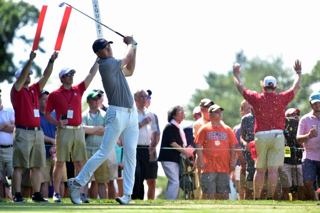 Jordan Spieth watches his tee shot on the 11th hole during the first round of the Travelers Championship at TPC River Highlands on Thursday. Fueled by an eagle on the par-5 fifth hole, Spieth shares the first-round lead with Zach Johnson at 7-under 63. (John Woike/Hartford Courant via AP)