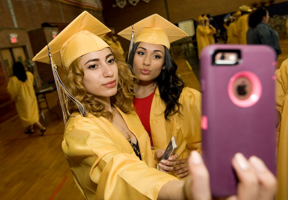 Ali Acevedo, 17, left, and friend, Isabelle Carmona, 18, snap a photo together before the start of graduation ceremonies at Platt High School, Thursday, June 9, 2016. | Dave Zajac, Record-Journal