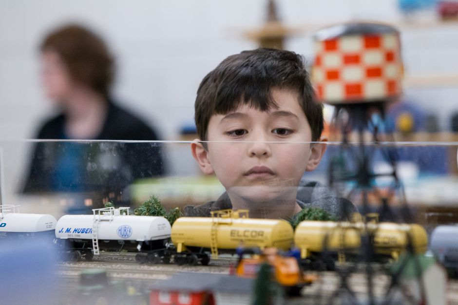 Alex Cahaly 7 of Greenwich watches a model train operate Sunday during a model train expo hosted by the Cheshire Marching Band at Cheshire High School in Cheshire Mar. 5, 2017 | Justin Weekes / For the Record-Journal