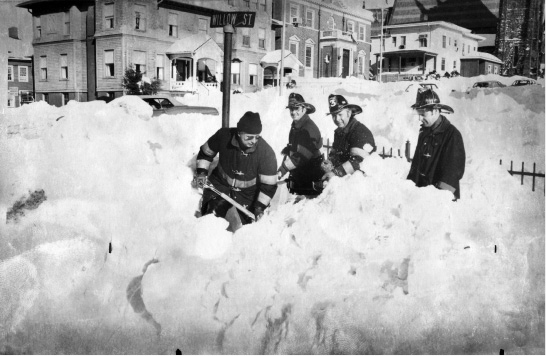 Meriden firefighers Charles Rigton, William Aitken, Larry Jankowski and Dan Tanner search for a fire hydrant after the Blizzard of 1978.  | File photo / Record-Journal