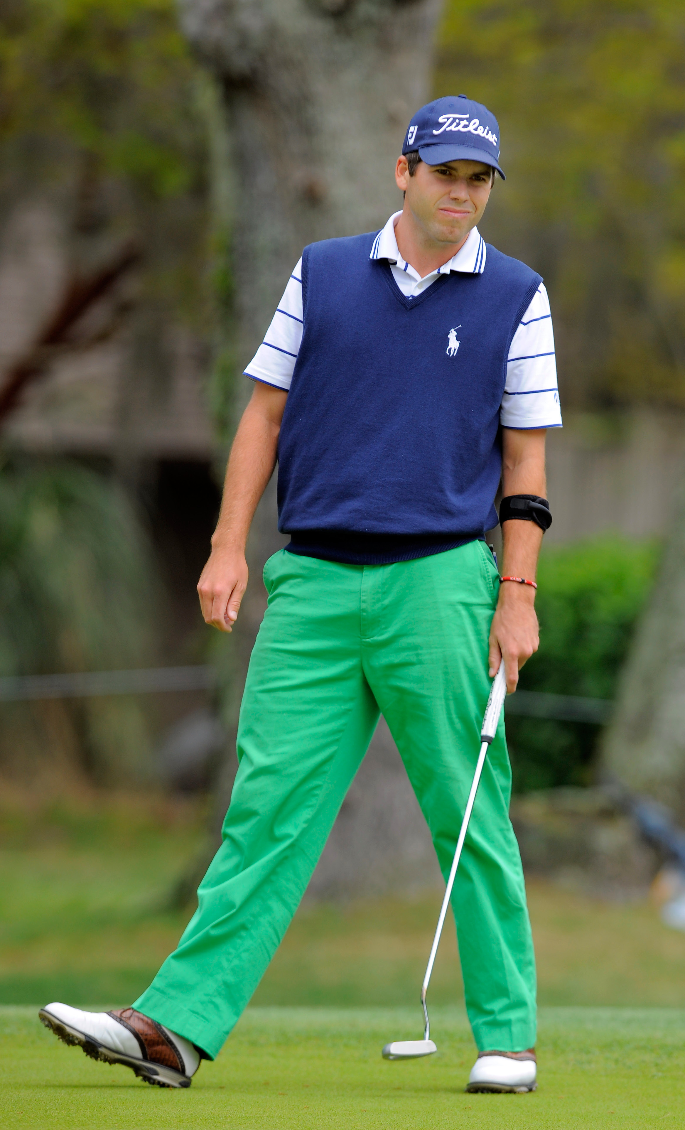 Ben Martin watches his birdie putt go in on the second hole during the final round of the RBC Heritage golf tournament in Hilton Head Island, S.C., Sunday, April 20, 2014. (AP Photo/Stephen B. Morton)