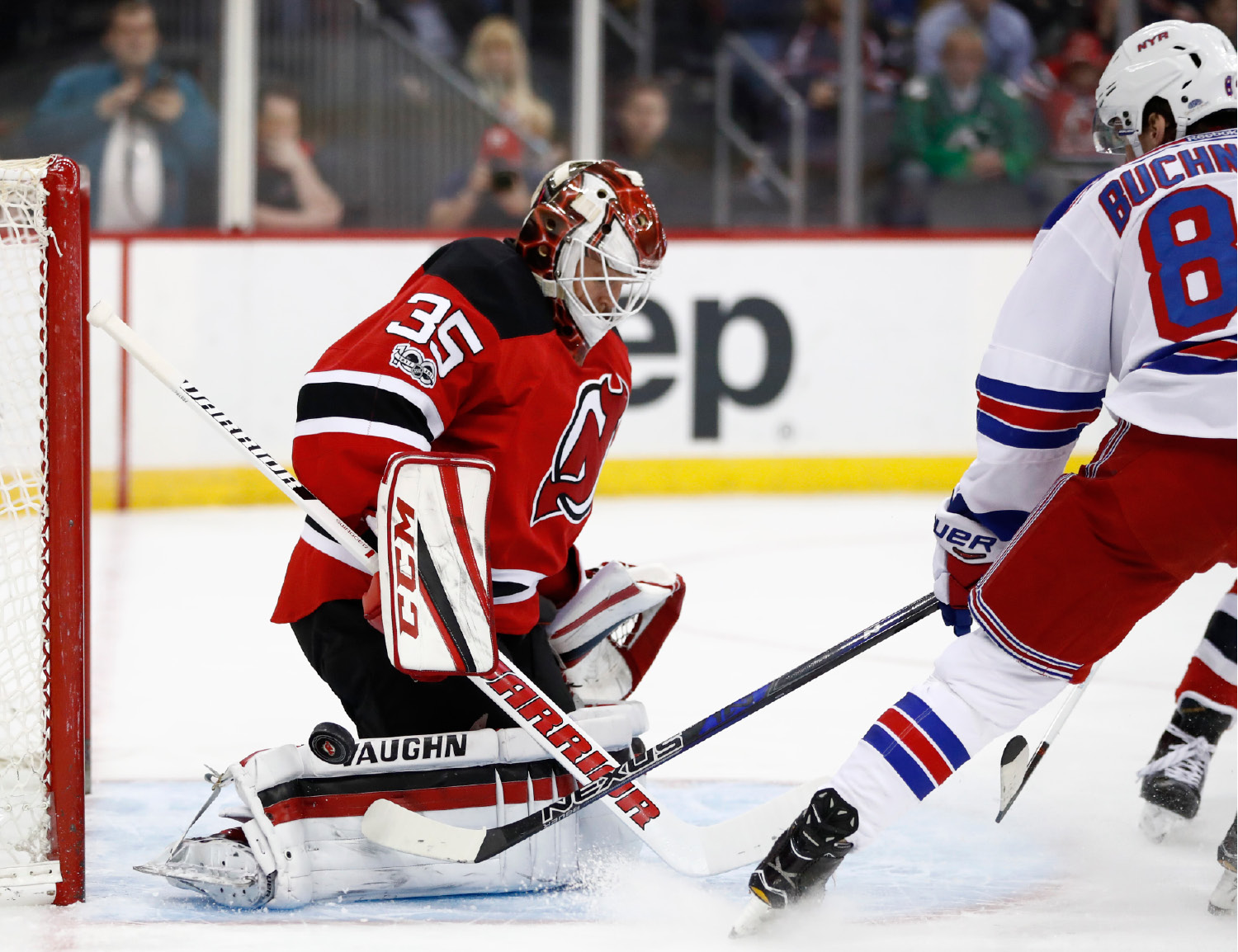New Jersey Devils goalie Cory Schneider (35) blocks a shot by New York Rangers right wing Pavel Buchnevich (89), of Russia, during the first period of an NHL hockey game, Tuesday, March 21, 2017, in Newark, N.J. (AP Photo/Julio Cortez)