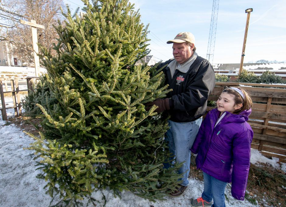 Dean and Gabby Acquaviva, of Southington, pick out a tree during Engine Company 2