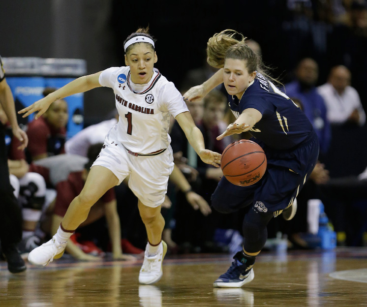 South Carolina guard Bianca Cuevas-Moore, left, and Quinnipiac guard Carly Fabbri scramble for the ball during the first half of a semi-final round game of an NCAA college basketball tournament , Saturday, March 25, 2017, in Stockton, Calif. (AP Photo/Rich Pedroncelli)