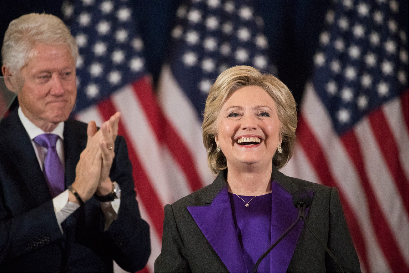 FILE - In this Wednesday, Nov. 9, 2016 file photo, former President Bill Clinton applauds as his wife, Democratic presidential candidate Hillary Clinton speaks in New York, where she conceded her defeat to Republican Donald Trump after the hard-fought presidential election. Hillary Clinton