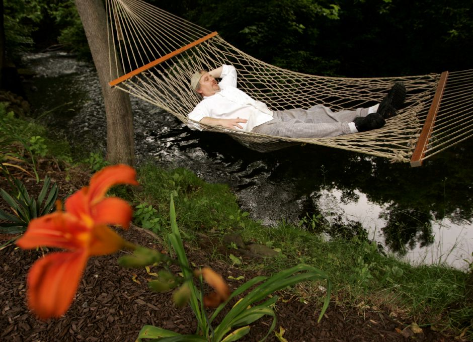 Chef Timothy Kesser relaxes in a hammock over the Quinnipiac River which flows directly behind Kess