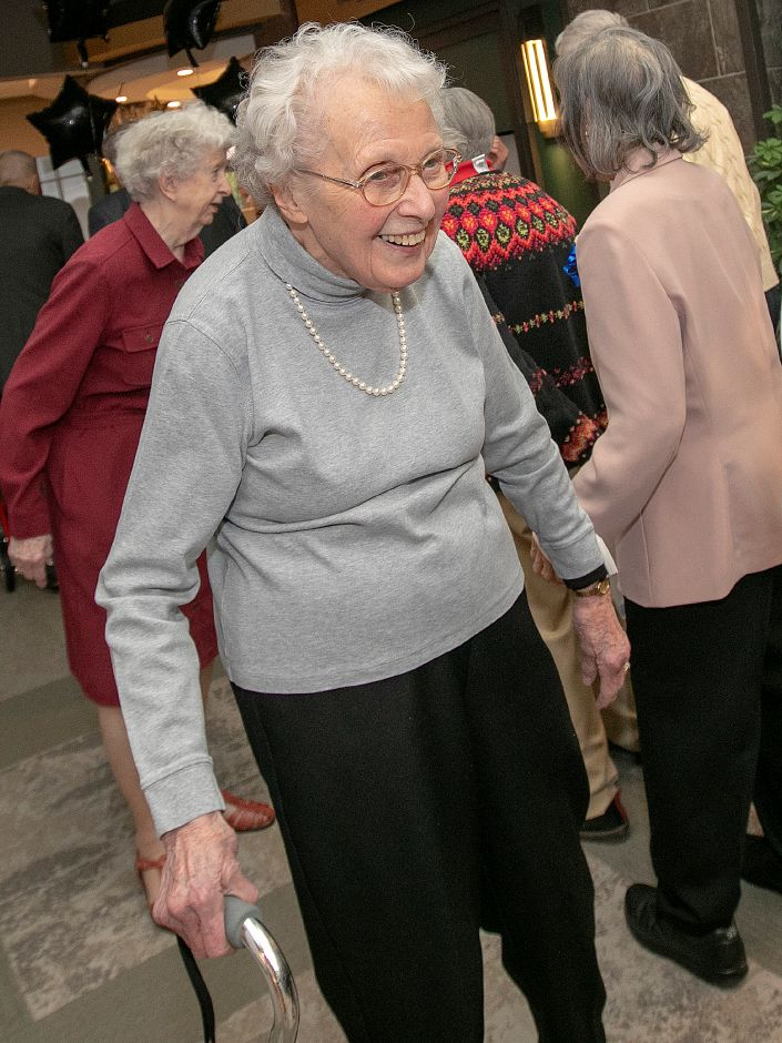 Elim Park resident Abby Bray smiles as she arrives for the annual senior citizen prom for residents of Elim Park, Fri., Mar. 1, 2019. The prom was organized by members of the Student Nurses Association at Quinnipiac University. Dave Zajac, Record-Journal