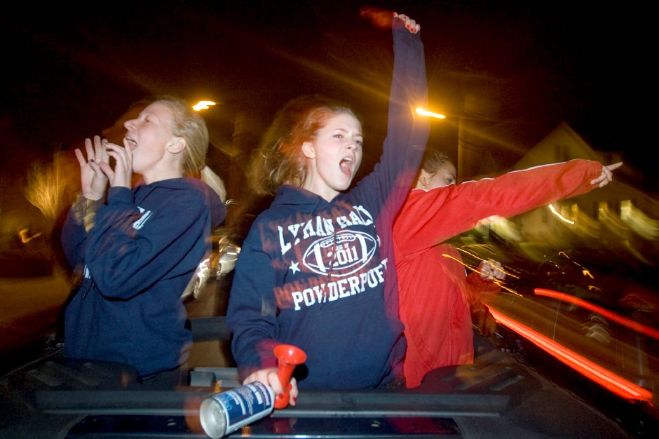 Left to right, Allie Weborg, Emily Ardito and Nicole Letis, Lyman Hall High School during the Powderpuff motorcade, just after Sheehan
