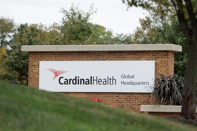 A sign is displayed at the Cardinal Health, Inc. corporate office Wednesday, Oct. 16, 2019, in Dublin, Ohio. Shares of big drug distributors soared Wednesday on word of a potential settlement ahead of the first federal trial over the opioid crisis. Two people with knowledge of the negotiations, which have lasted months, confirmed to The Associated Press that McKesson Corp., AmerisourceBergen Corp., and Cardinal Health, Inc., have offered $18 billion over 18 years to settle more than...