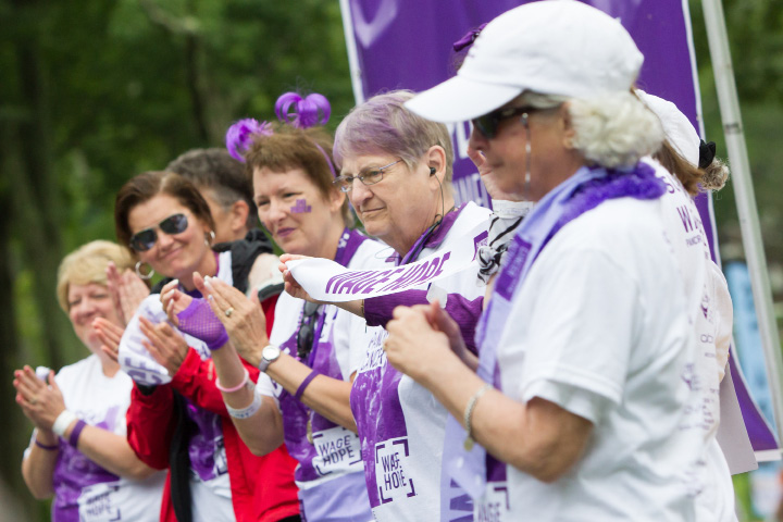 Survivors are recognized before the start Saturday during the PurpleStride 5k and walk fundraiser for Pancreatic Cancer Action Network at Hubbard Park in Meriden Jun. 17, 2017 | Justin Weekes / For the Record-Journal