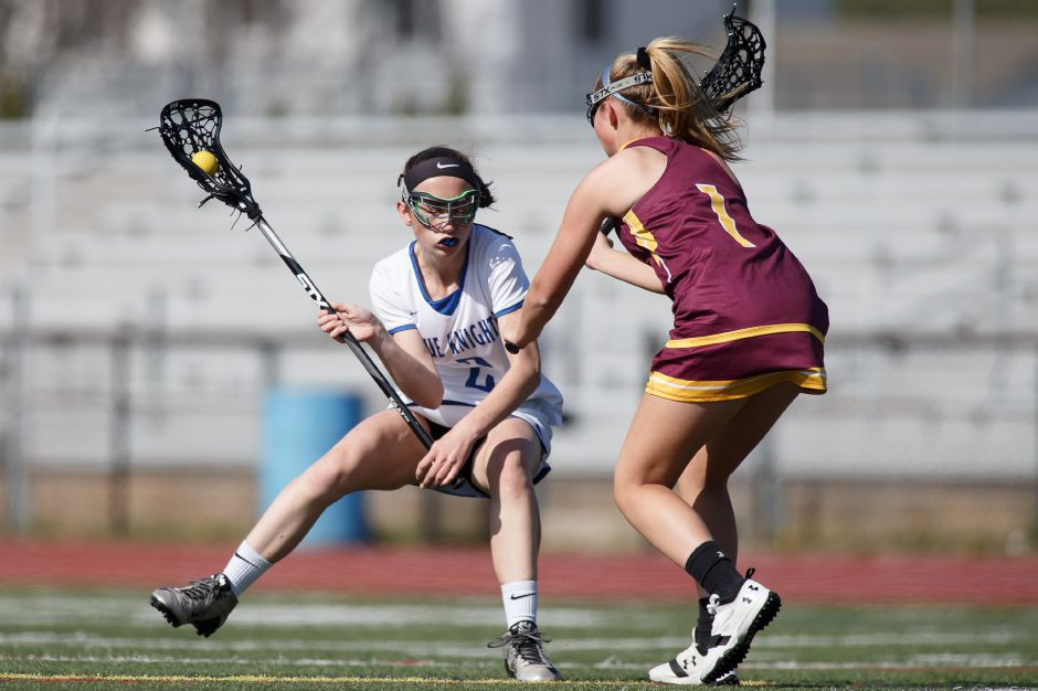 Emma Doran works past a South Windsor defender in Tuesday's game at Southington High School. Doran, a sophomore, had five goals in Southington's 16-11 victory. | Justin Weekes / Special to the Record-Journal