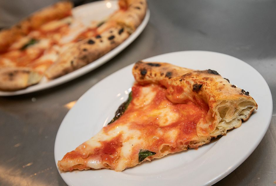 A margherita pizza slice featuring a soft crust at the new Mamma Mia Restaurant at 1765 Meriden-Waterbury Tpke. in Southington, Fri., Nov. 30, 2018. Dave Zajac, Record-Journal