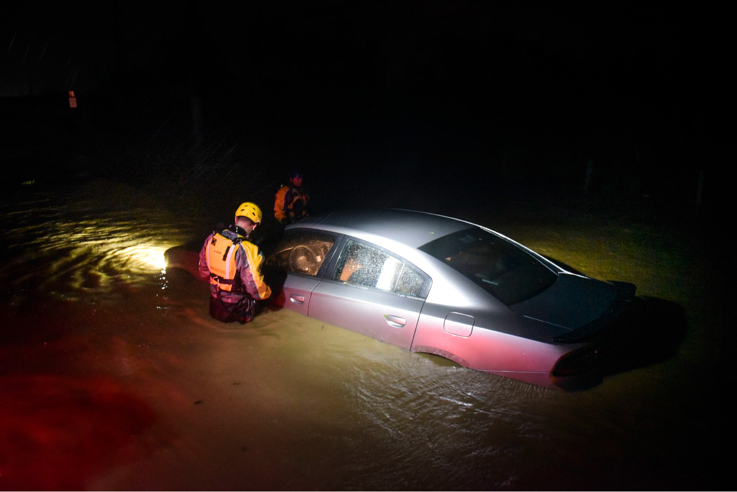 Rescue staff from the Municipal Emergency Management Agency investigate an empty flooded during the passage of Hurricane Irma through the northeastern part of the island in Fajardo, Puerto Rico, Wednesday, Sept. 6, 2017. Hurricane Irma lashed Puerto Rico with heavy rain and powerful winds, leaving nearly 900,000 people without power as authorities struggled to get aid to small Caribbean islands already devastated by the historic storm.(AP Photo/Carlos Giusti)