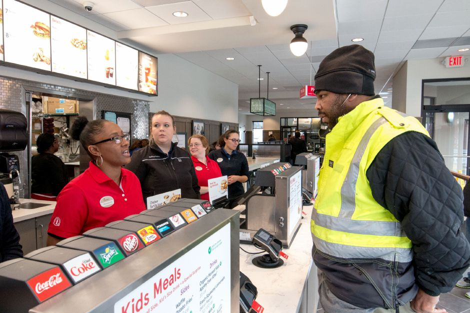Sherawn Johnson, of Waterbury, orders a meal from Marquetta Gill, of Naugatuck, on the opening day of the Southington Chick-Fil-A on Thursday. | Devin Leith-Yessian/Record-Journal