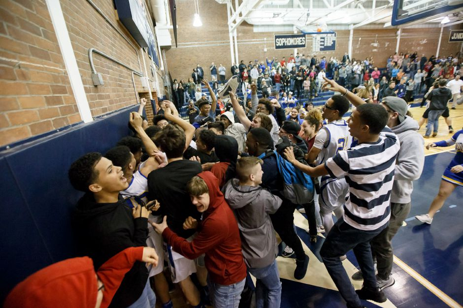 Wilcox Tech players, cheerleaders and fans celebrate after defeating SMSA 70-67 Monday night in the CIAC Division IV quarterfinals at Platt High School in Meriden. More photos online at myrecordjournal.com Justin Weekes, Special to the Record-Journal