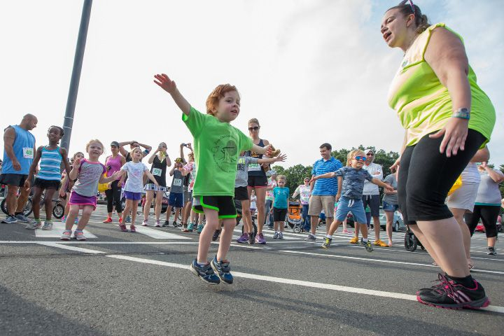 FILE PHOTO: Elijah Lanigan 3 of Southington warms up with jumping jacks before the kids fun run Sunday during the GE 5 K Petit Road Race to benefit the Petit Family Foundation in Plainville Jul. 17, 2016 | Justin Weekes / For the Record-Journal