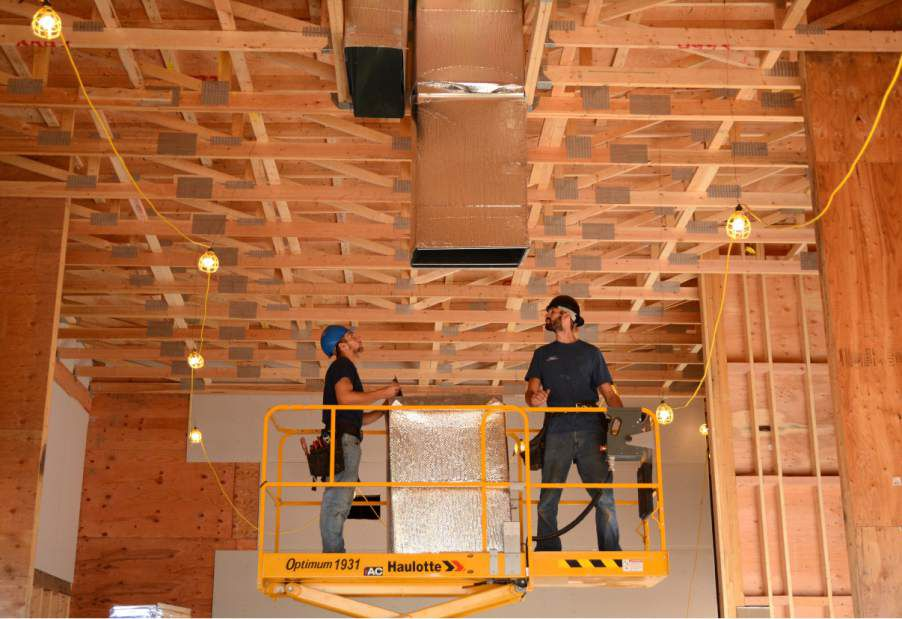 Evan Gagliardi (L.) and Bobby Rulewicz work on construction inside the future Popeyes Louisana Kitchen, 1095 West St., Southington, on Friday, Oct. 20, 2017. | Bryan Lipiner, Record-Journal