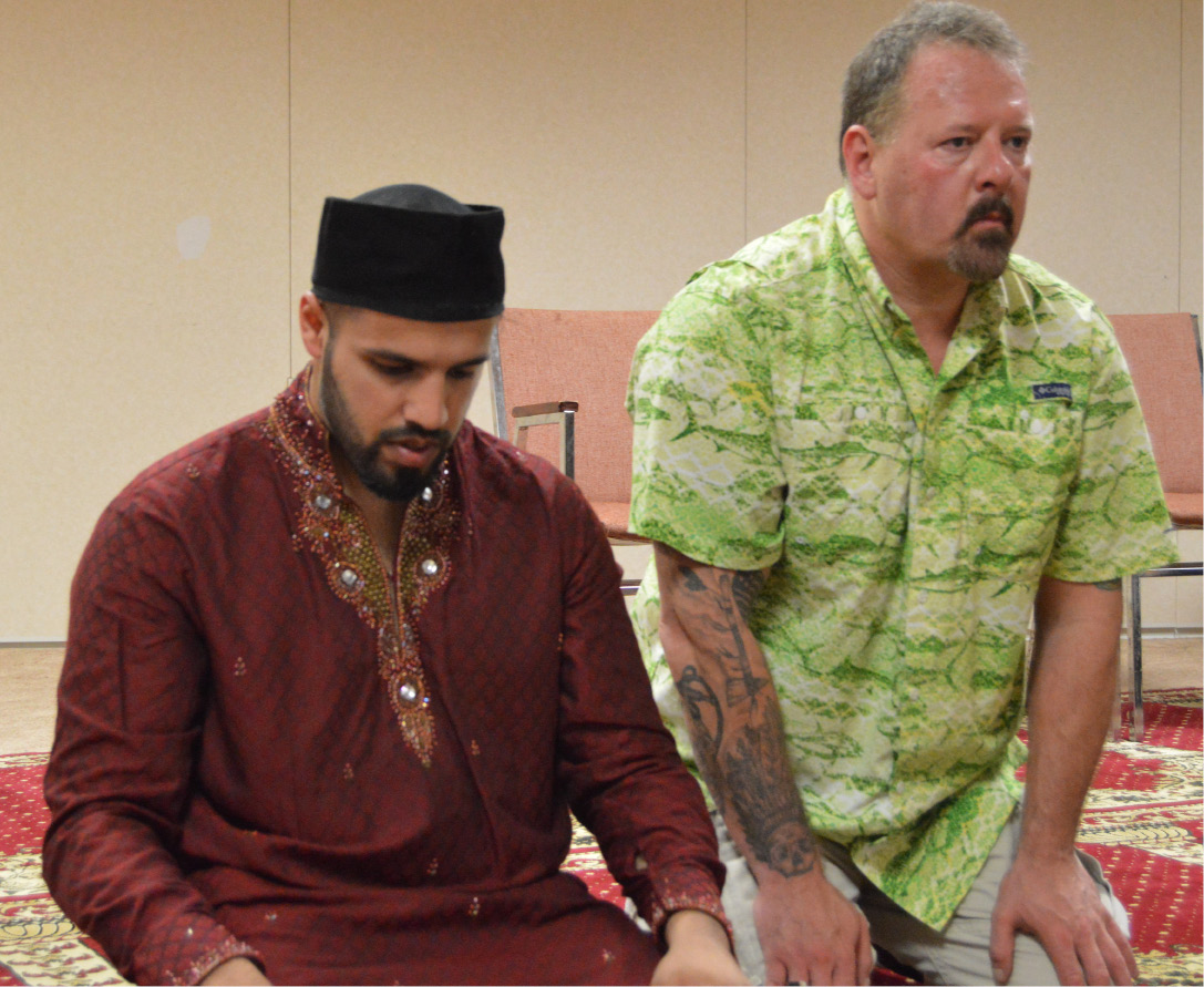 Ted Hakey, right, prays alongside Zahir Mannan, outreach director for the Baitul Aman mosque in Meriden. Hakey fired at the mosque with a high-powered rifle eight months ago, but he has since become friendly with members and is working to educate others about Islam. | Mike Savino, Record-Journal
