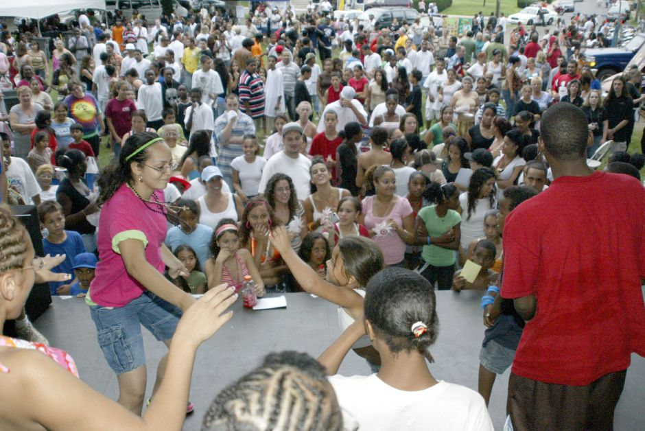 MERIDEN, Connecticut - Tuesday, August 7, 2007 - People dance on stage to hip-hop tunes while a packed City Park watches and takes part in the festivities of National Night Out on Tuesday. Rob Beecher / Record-Journal