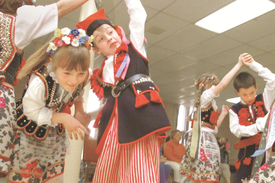 RJ file photo - Natalia Pajor, 8, of Wallingford, gracefully moves under the arched arms of David Remiszewski of Wallingford and other children during a performance by the Polish dance troupe Mazowsze, May 1999.