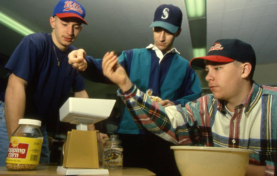 RJ file photo - Platt students Ben Michaud, Frank Scotto and Jeff Prescott work out a popcorn problem in applied mathematics class Jan. 24, 1994.