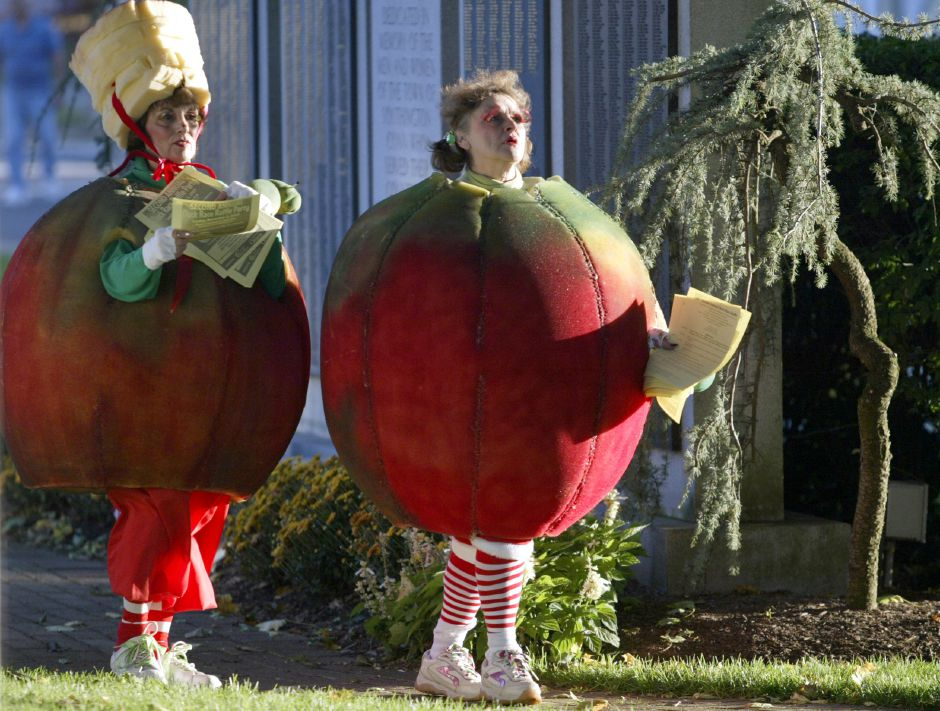 SOUTHINGTON, Connecticut - Friday, September 28, 2007 - Addie Monteleone, left and Joanne Salerno, dressed as life-sized apples, walk through the green and hand out flyers on Friday, the opening day for the Apple Harvest Festival on Main Street in Southington. Rob Beecher / Record-Journal