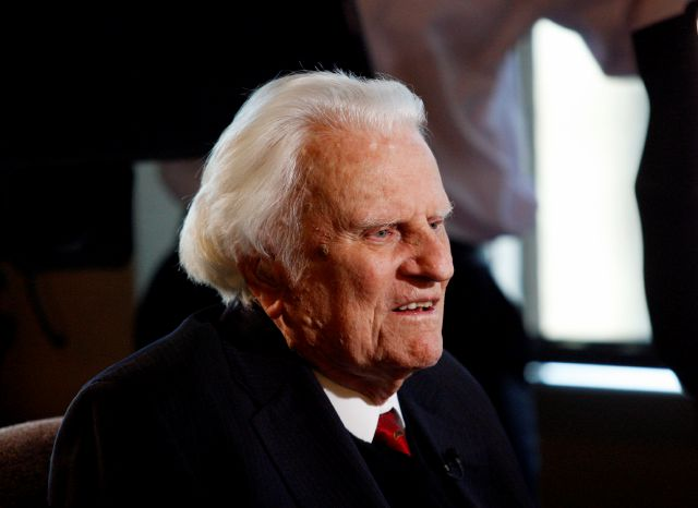FILE - In this Dec. 20, 2010 file photo, evangelist Billy Graham, 92, speaks during an interview at the Billy Graham Evangelistic Association headquarters in Charlotte, N.C. Graham, who transformed American religious life through his preaching and activism, becoming a counselor to presidents and the most widely heard Christian evangelist in history, has died. Spokesman Mark DeMoss says Graham, who long suffered from cancer, pneumonia and other ailments, died at his home in North...
