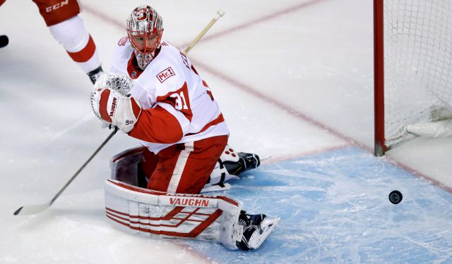 Detroit Red Wings goaltender Jared Coreau looks back at the puck on a goal by Boston Bruins defenseman Torey Krug during the first period of an NHL hockey game in Boston, Tuesday, March 6, 2018. (AP Photo/Charles Krupa)