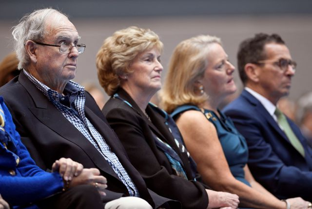 Former Connecticut Governors Lowell P. Weicker, left, M. Jodi Rell, second from left, and Dannel P. Malloy, right, with his wife Cathy, listen during the inauguration of Gov. Ned Lamont, Wednesday, Jan. 9, 2019, inside the William A. O