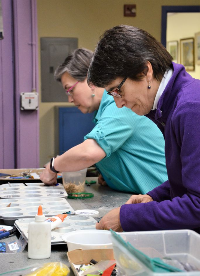Andrea Stelma (right) and Marylou Shoemaker (left) work on their own fused glass jewelry.